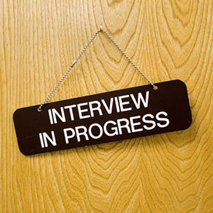 A sign on a door that says interview in progress