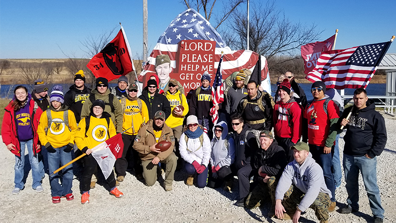 Student Veterans from Nebraska and Iowa meet at Freedom Rock in Menlo, IA during annual Ruck March to raise awareness about veteran health concerns